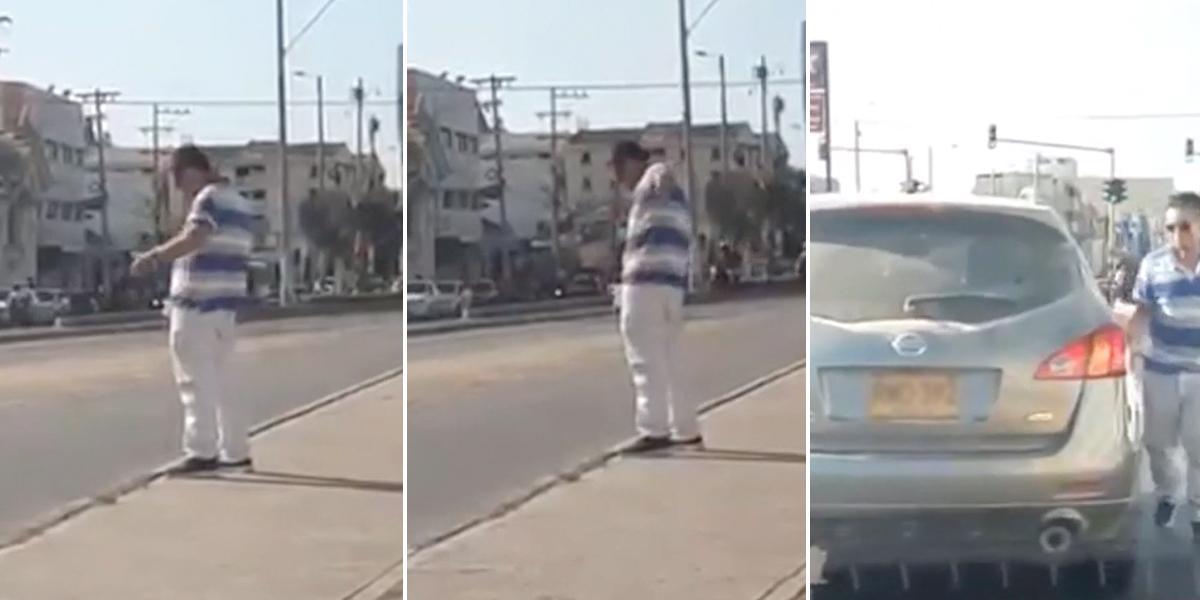 En plena vía pública y provocando trancón, a un hombre se le ocurre parar a orinar en Cartagena